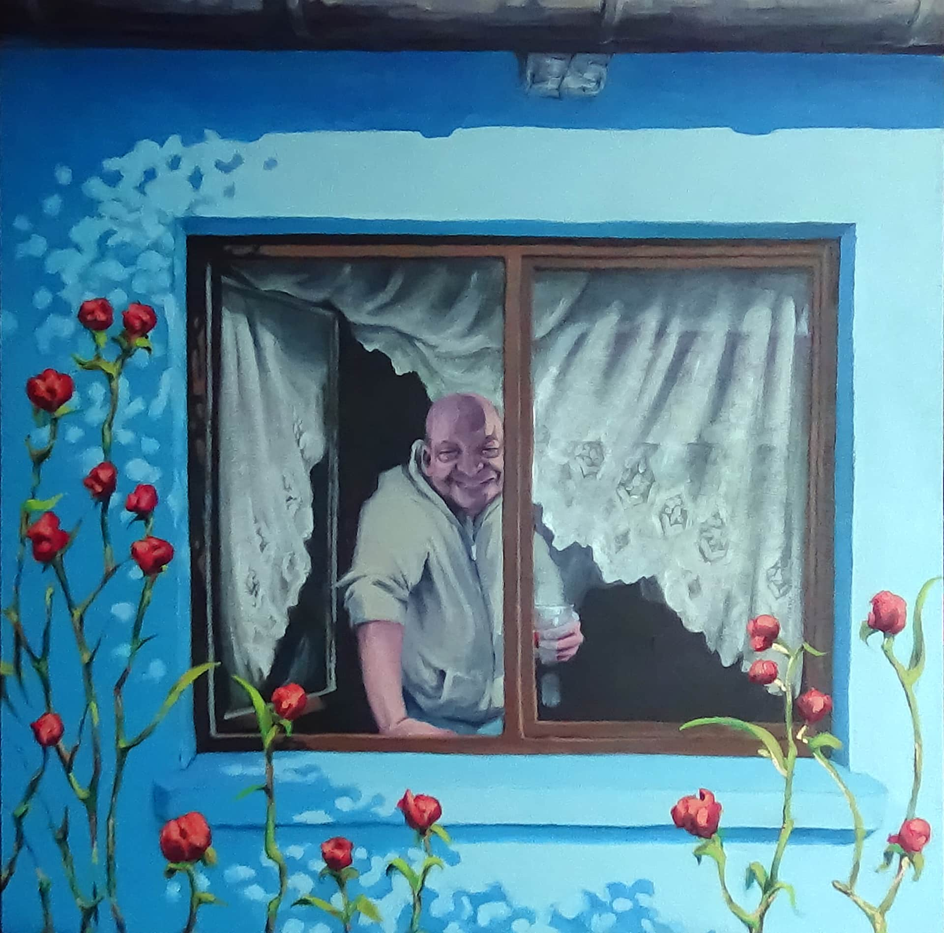 Tomasz Kruczek w oknie jednej z ostatnich bronowickich chat. Autor obrazu: Patryk Tyburkiewicz.